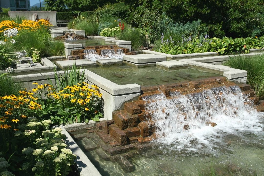 Ponds water features custom reef creations for Koi pond maintenance near me